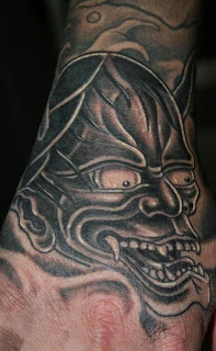 Biomechanical Asian Demon Hand Tatoo