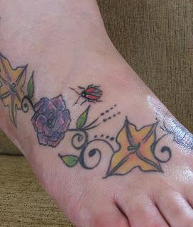 Flowers Leaves and Ladybug tattoos
