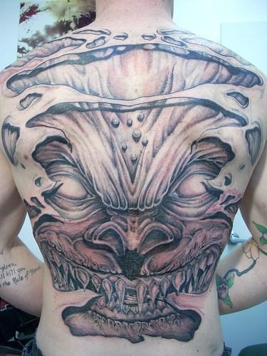 skin rip tattoo. Large Skin Rip Demon Devil Back Tattoo
