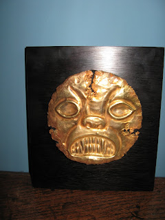 Moche gold burial mask of a shaman transforming into a jaguar