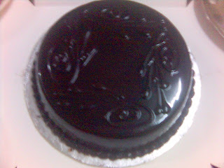 Very delicious shinning and smooth chocolate cake.