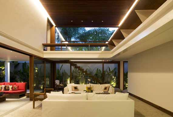 Extensive Use Of Glass, White Marble And Timber Ensures Plenty Of Natural  Lighting And A Home That Blends Seamlessly With Its Surroundings.