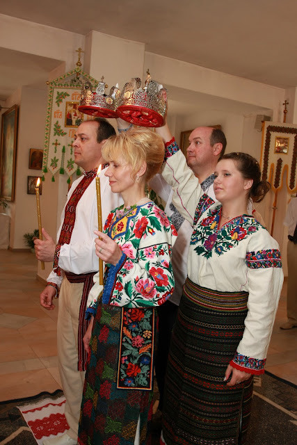 Holding crowns at wedding in Ukraine