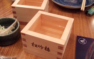 A wooden small box with Japanese cold sake