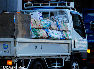 A small truck for collecting old papers to recycle, Tokyo