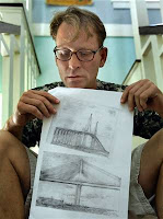 Courtesy Chris O'Meara / AP Hanns Jones holds drawings he made of the Sunshine Skyway Bridge in St. Petersburg, Fla. He survived a jump from the bridge on May 30, 2001. Jones says he's fine and happy today, and he often wonders why he survived when so many others didn't.