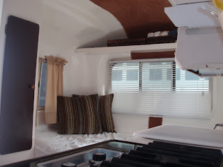 The Front Of Camper Has Sofa Bunk Beds Here You See There Is Amble Storage Under As Well For A Port Potty Or Childrens
