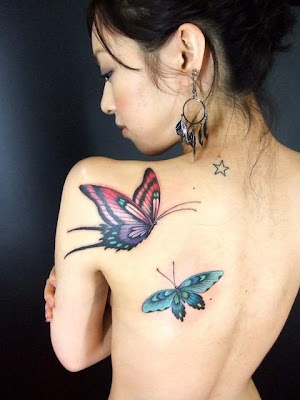 Sexy girl with butterfly tattoo on back body, tribal tattoo on stomach,