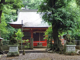 small shinto shrine in the light rain
