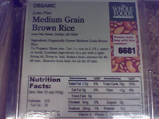 Brown rice label on bulk bin in grocery store