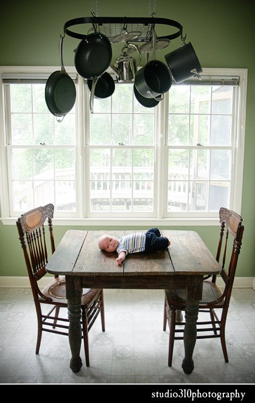 child photography on an antique table in raleigh nc by studio 310