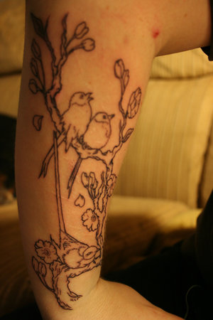 With Cherry Blossom Tattoo