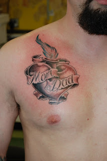 Heart Tattoos With Image A Male Tattoo With Heart Tattoo Designs On The Body Picture 8