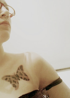 Female Chest tattoo With Butterfly Tattoo Design 5