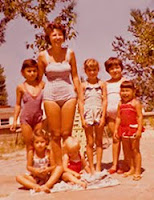 photo circa 1962 of a group of children in beach attire