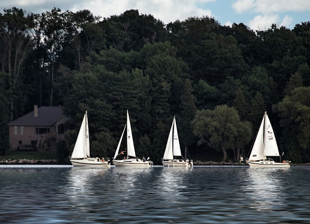 Small sailboats in early evening on Lake Couchiching