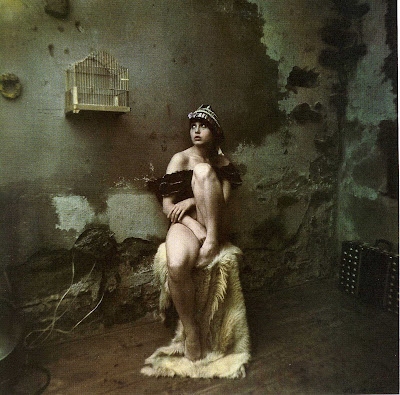 Olga_with_birdcage_by_Jan_Saudek_1978.jpg