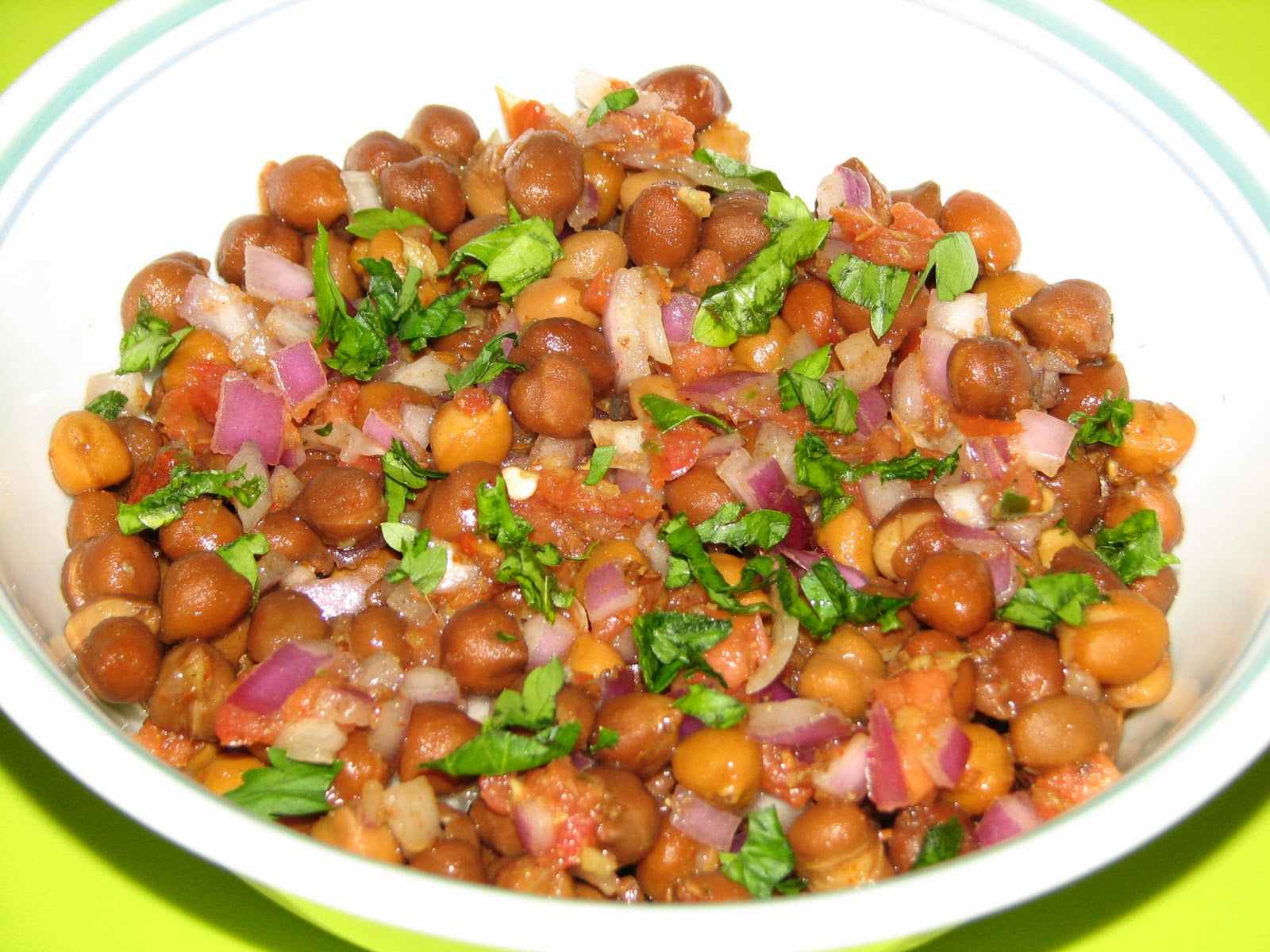 In a bowl add chana, onion and tomato and mix well