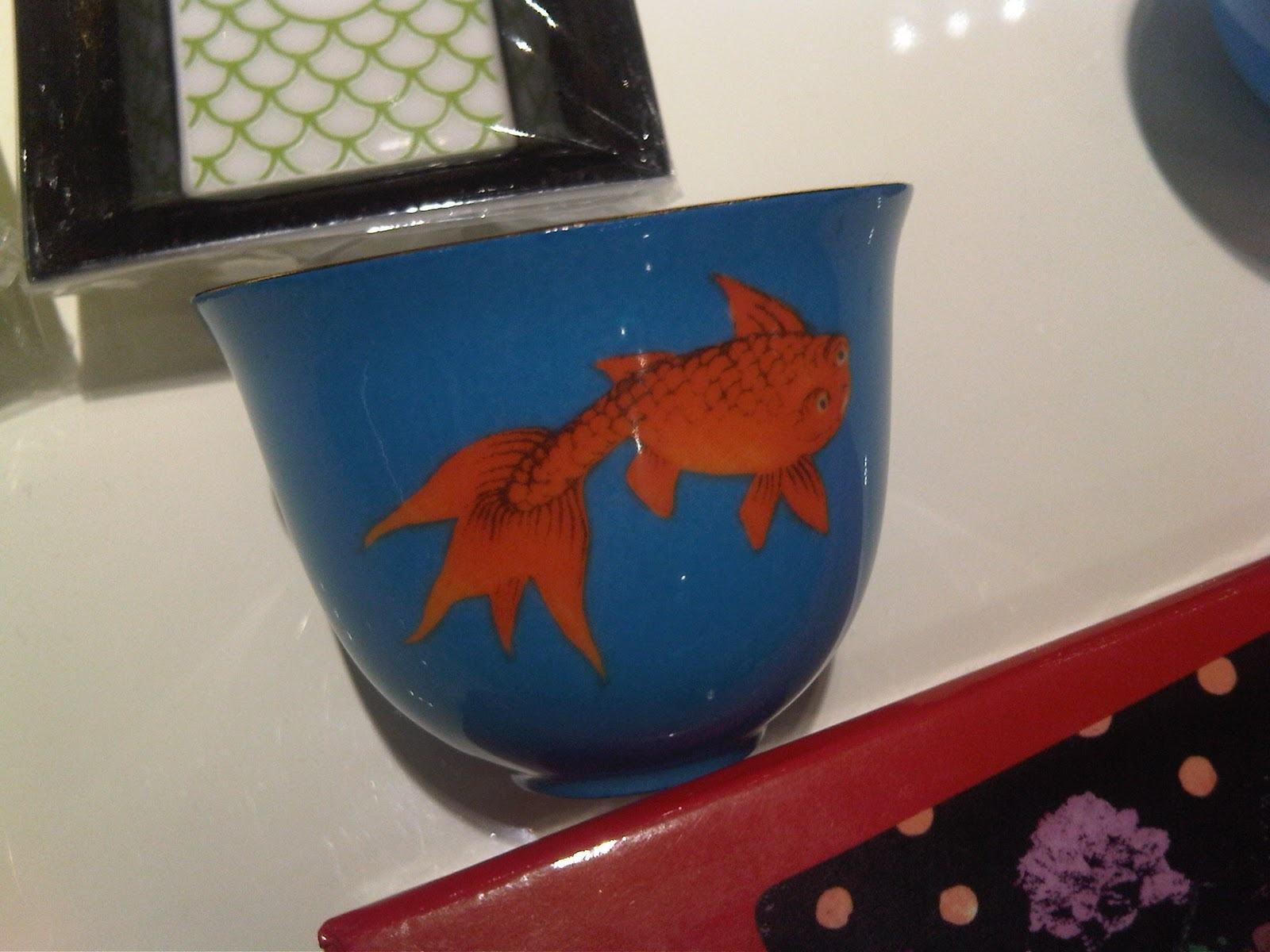 cups with koi fish design