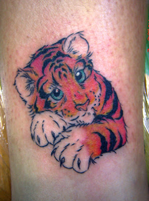 Cute tiger tattoo on the leg