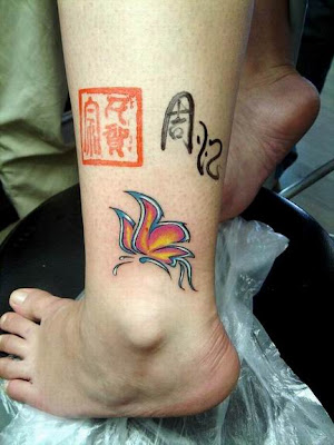 Butterfly tattoo on the ankle.