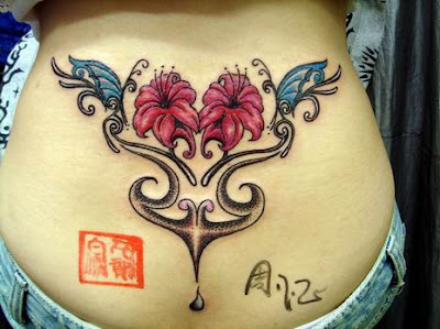 Lower back butterfly and flower tattoo