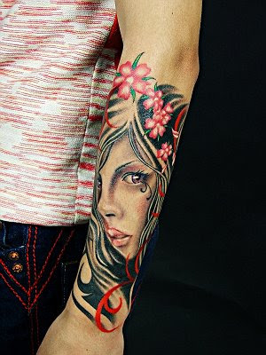 colorful beauty portrait tattoo on the arm