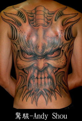 Full back face expression tattoo by Andy Shou