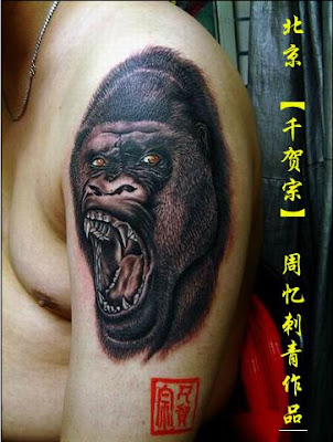 Gorilla tattoo design on the arm