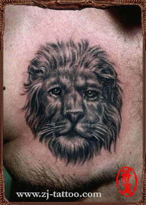 A humanized lion tattoo on the chest