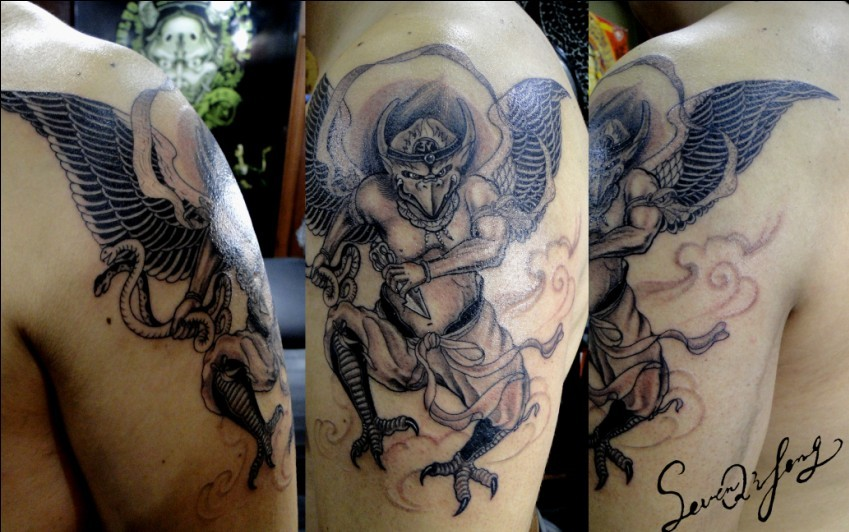 demon tattoo on the arm