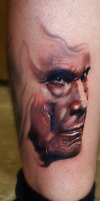 Man's Portrait tattoo on the leg