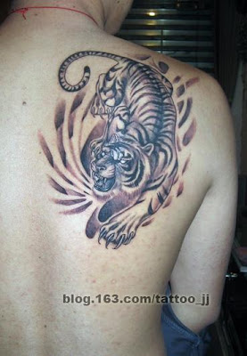 A tattoo featuring a tiger running for his prey.