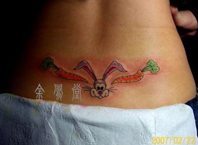 Cartoon bunny tattoo on the hip