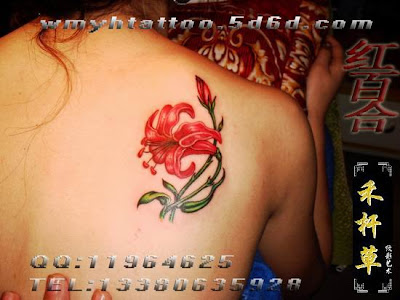 Red flower tattoo on the back