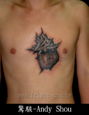 A lifelike hear tattoo on the chest by Andy Shou.
