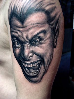 This free tattoo design is possibly a vampire's ugly smiling face (why
