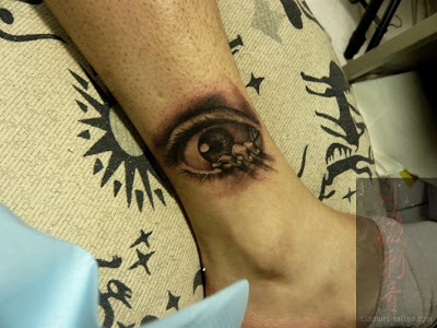 What a weird combination of things for this tattoo! Eyes, fingers, near feet