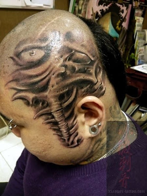 Very rare tattoo - never seen a guy got fully inked on his head and face.