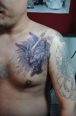 dragon and demon head tattoo design