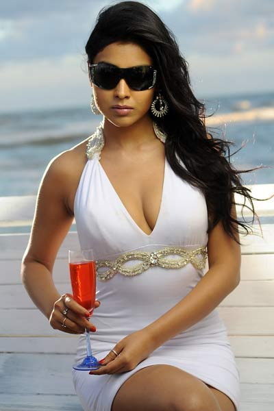 Shirya Saran in White Short Skirt @ Beach Holiday Resort Photos