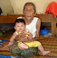 Old woman with young baby boy