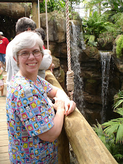 Becky by Waterfall inside of Amazonia Exhibit