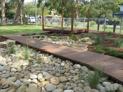 let the children play dry creek beds in a preschool playscape