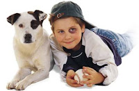 boy with black eye and dog