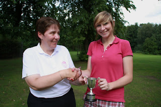 Captain Lesley presents trophy to Emma-click to enlarge