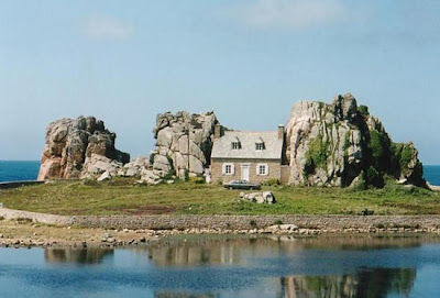 house between two boulders
