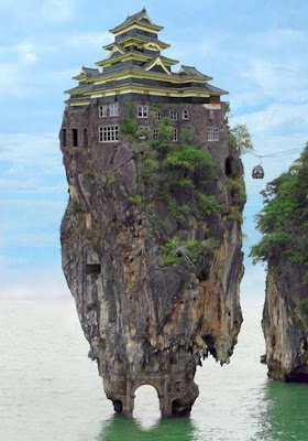 picture of a house on a rock