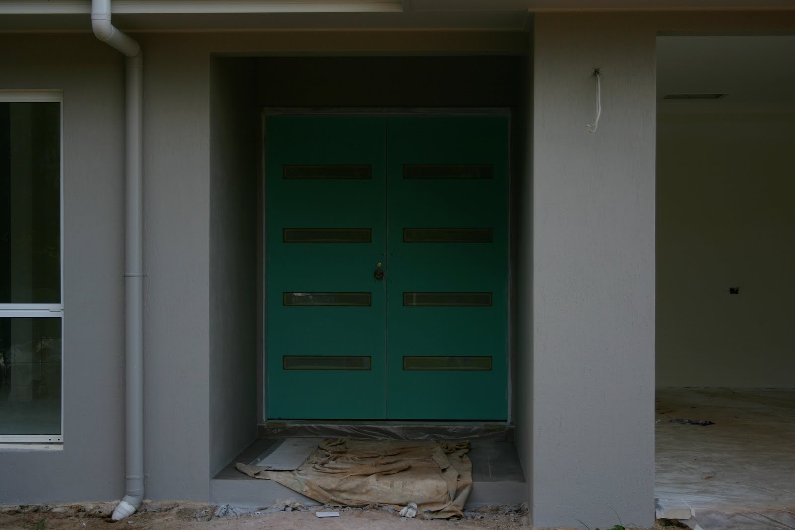 The front door, still to be painted (same as exterior, Dune) and  title=