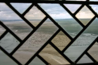 The beach at Mont St-Michel, Normandy, France, as seen through transfigured beach... the medieval glass of Mont St-Michel